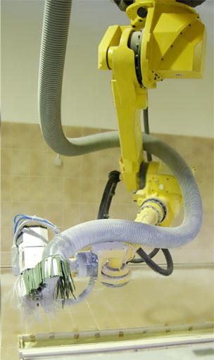 Робот для обработки композитов